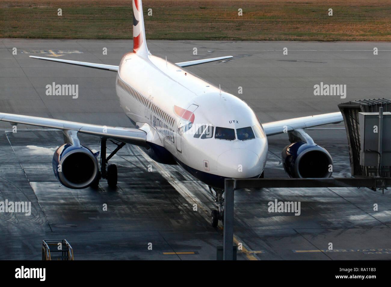 BA arrival. at the gate, Heathrow airport. London UK. Terminal 5, BA. - Stock Image