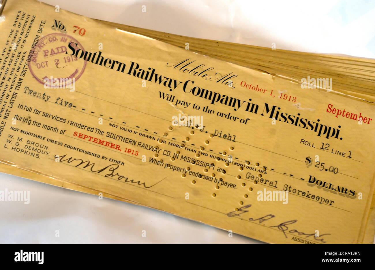 A railroad worker's cancelled paycheck, dated 1913, is pictured at the Meridian Railroad Museum on Jan. 15, 2011 in Meridian, Mississippi. - Stock Image