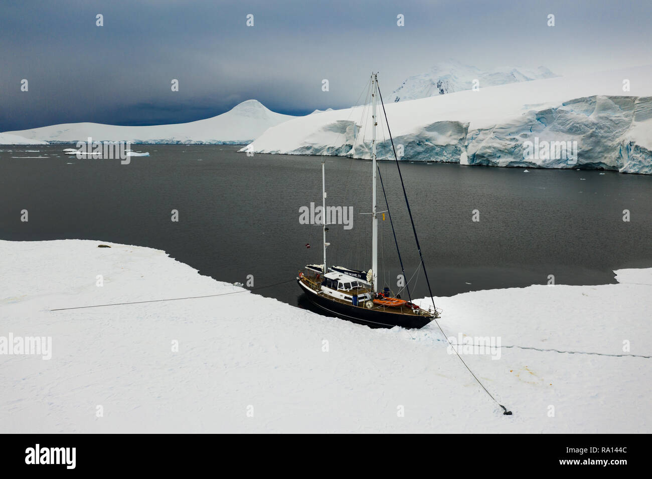 Docking / anchoring the sail boat to the sea ice near Port Lockroy, Antarctica - Stock Image