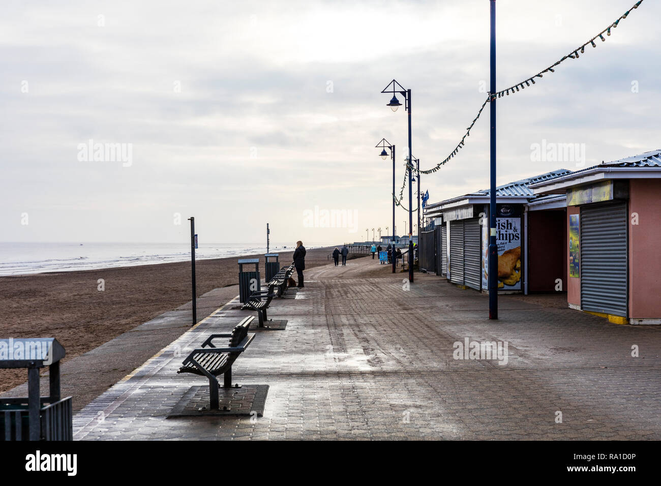 Mablethorpe, Lincolnshire, UK. 30th December 2018. Overcast skies on the East Coast of the UK at Mablethorpe beach 30/12/2018 cloudy sky with the sun trying to burn through Credit: Tommy  (Louth)/Alamy Live News Stock Photo