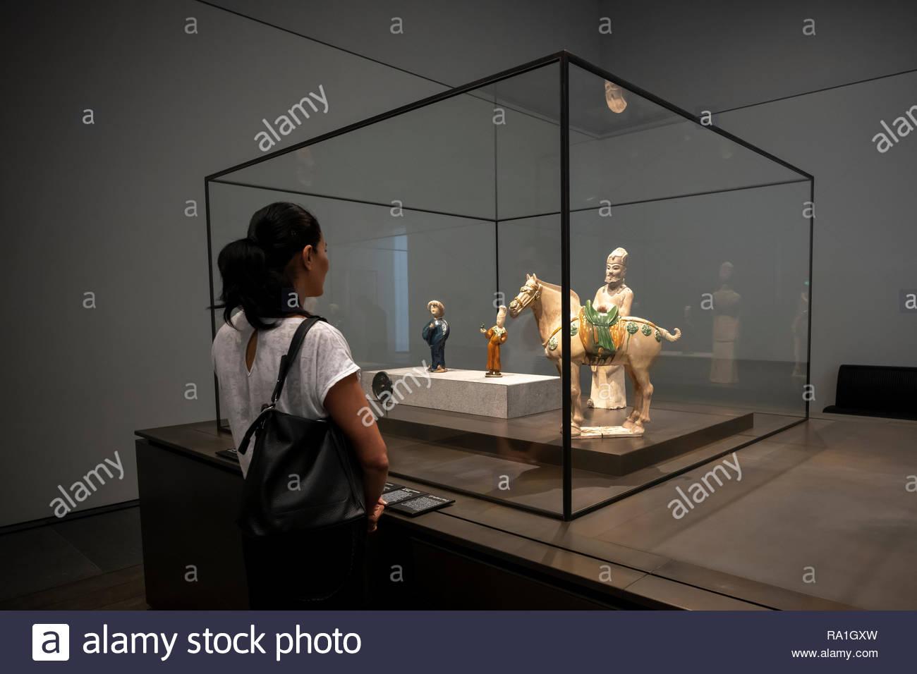 Abu Dhabi, UAE  30th Dec 2018  Tourist looking at statuettes