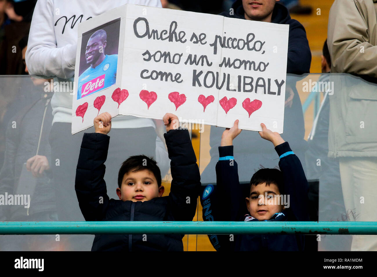 Napoli, Campania, Italy, 29-12-18, Serie A football match SSC Napoli Bologna at the San Paolo Stadium the fans of napoli with the photo of Koulibaly - Stock Image