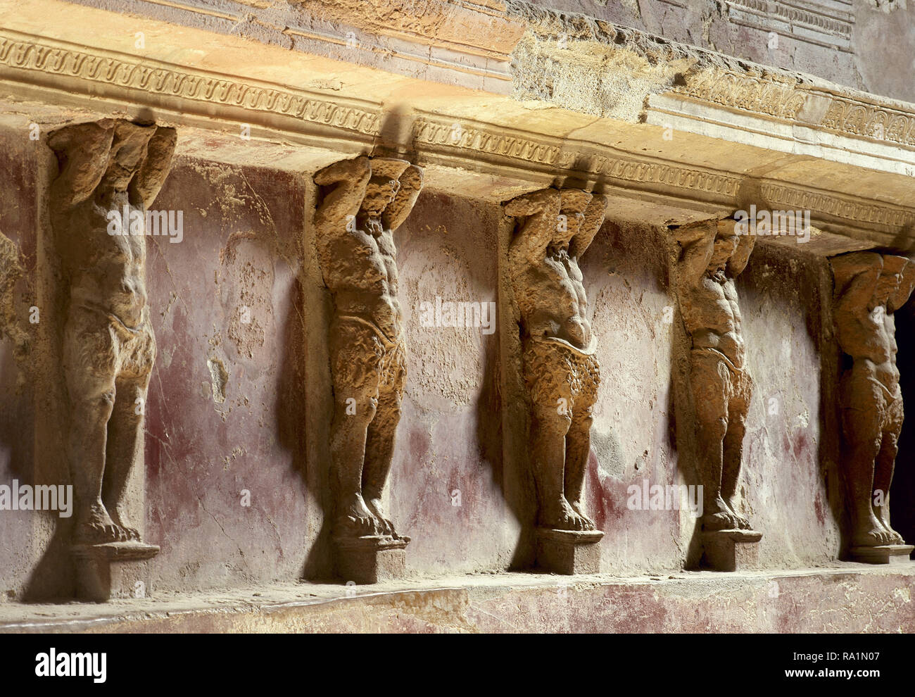 Italy. Pompeii. The Forum thermal baths. Public baths, edificated immediately after the founding of the colony (after 80 BC). They were subdivided into men's and women's section. Tepidarium (warm room). Detail of Telamons. Inside. Campania. - Stock Image