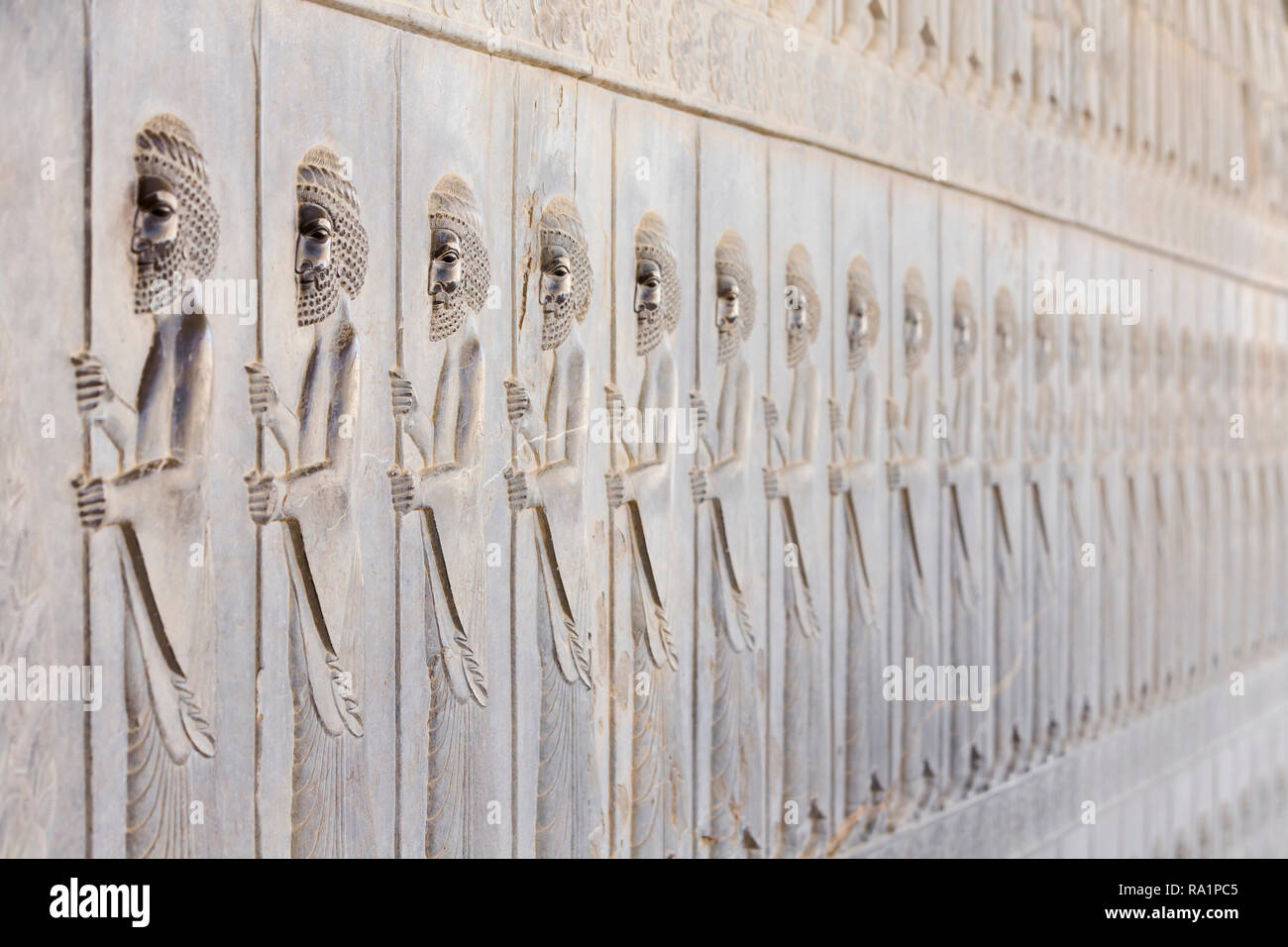 Bas reliefs on the walls of Apadana palace and staircase, Persepolis, Iran - Stock Image