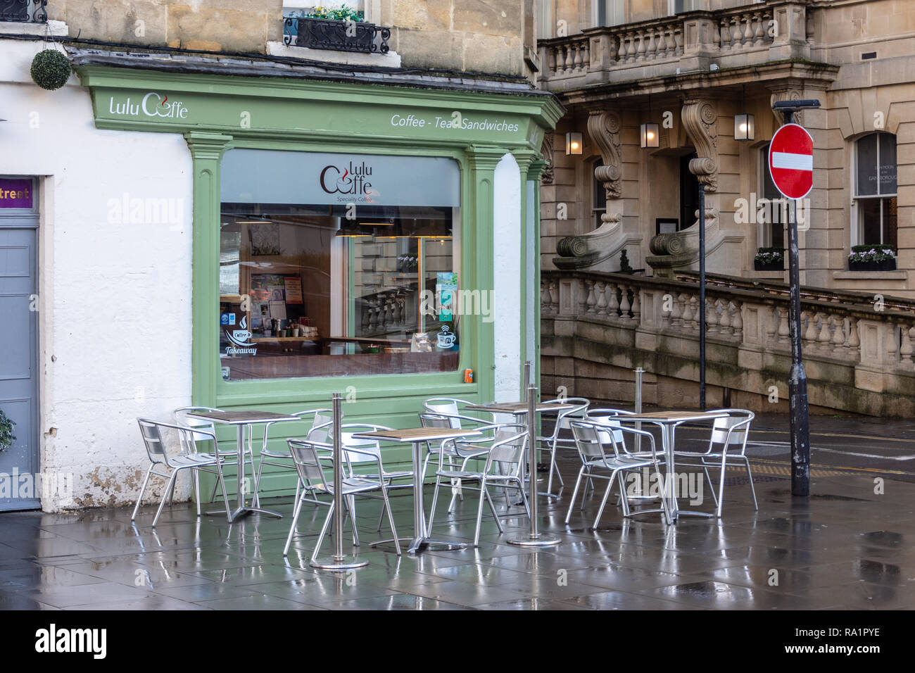 Lulu Caffe speciality coffee shop with chairs and tables outside  on Hot Bath Street in the city of Bath on a wet winter morning - Stock Image