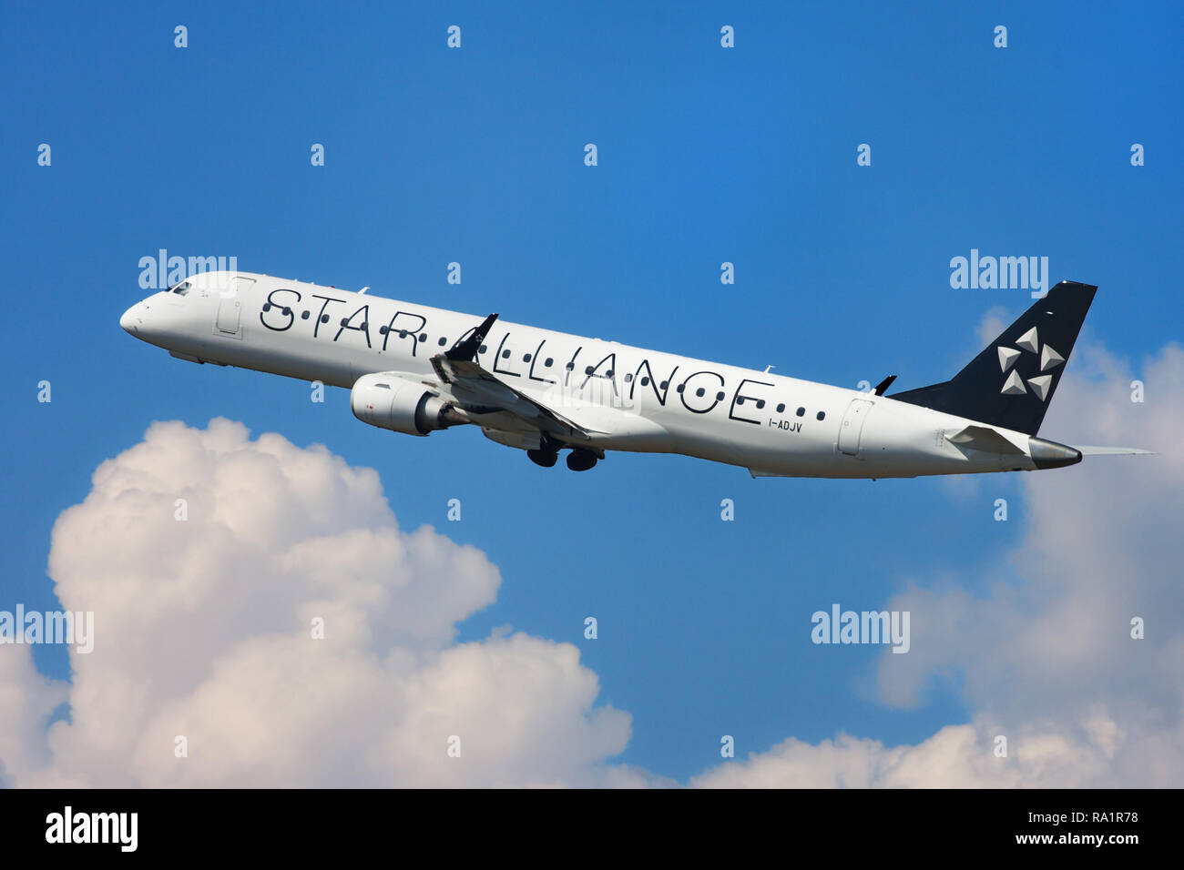 Barcelona, Spain - September 16, 2018: Air Dolomiti Embraer ERJ-195LR with Star Alliance Livery taking off from El Prat Airport in Barcelona, Spain. - Stock Image