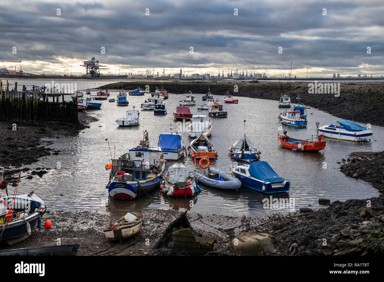Paddy's Hole, South Gare, Redcar, with the Heavy Industrial Landscape of Teesside Beyond, Teesmouth, North East England, UK - Stock Image