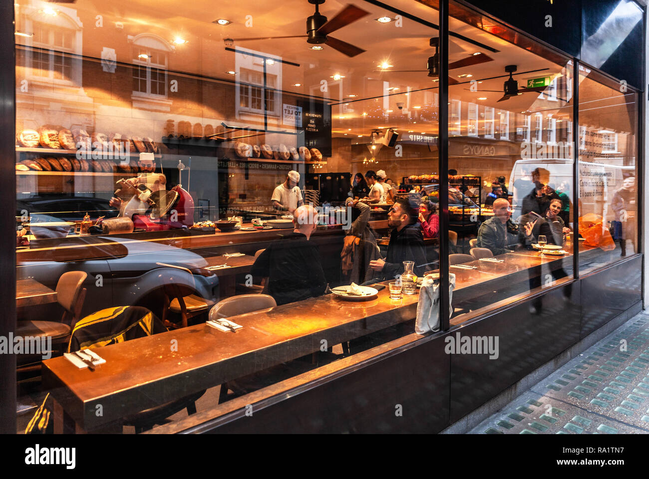 Customers inside Princi bakery, Wardour street, Soho, London, England, UK. - Stock Image