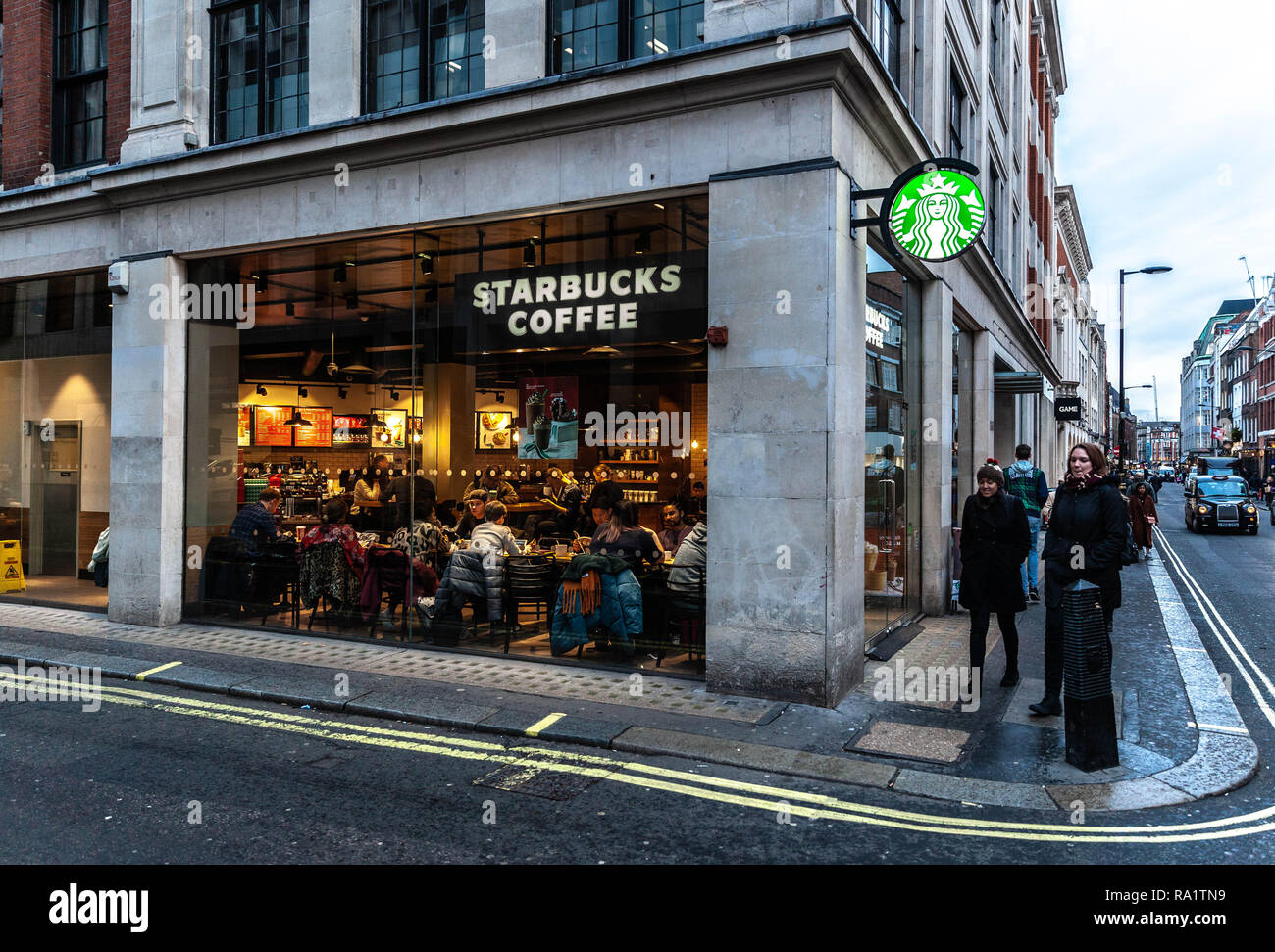 Starbucks Coffee shop on the corner of Wardour and Hollen street, Soho, London, W1, England, UK. - Stock Image