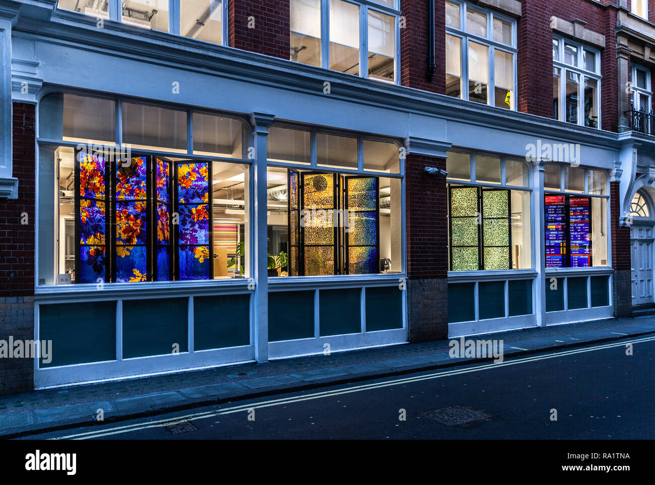 External colourful windows on a commercial premises, Soho, London, England, UK. - Stock Image
