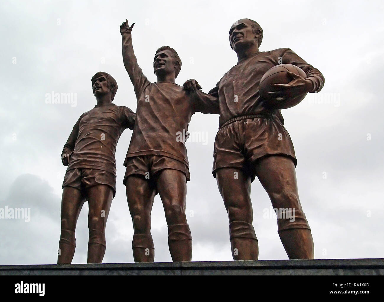 Charlton , Best and Law Statue at Old Trafford. - Stock Image