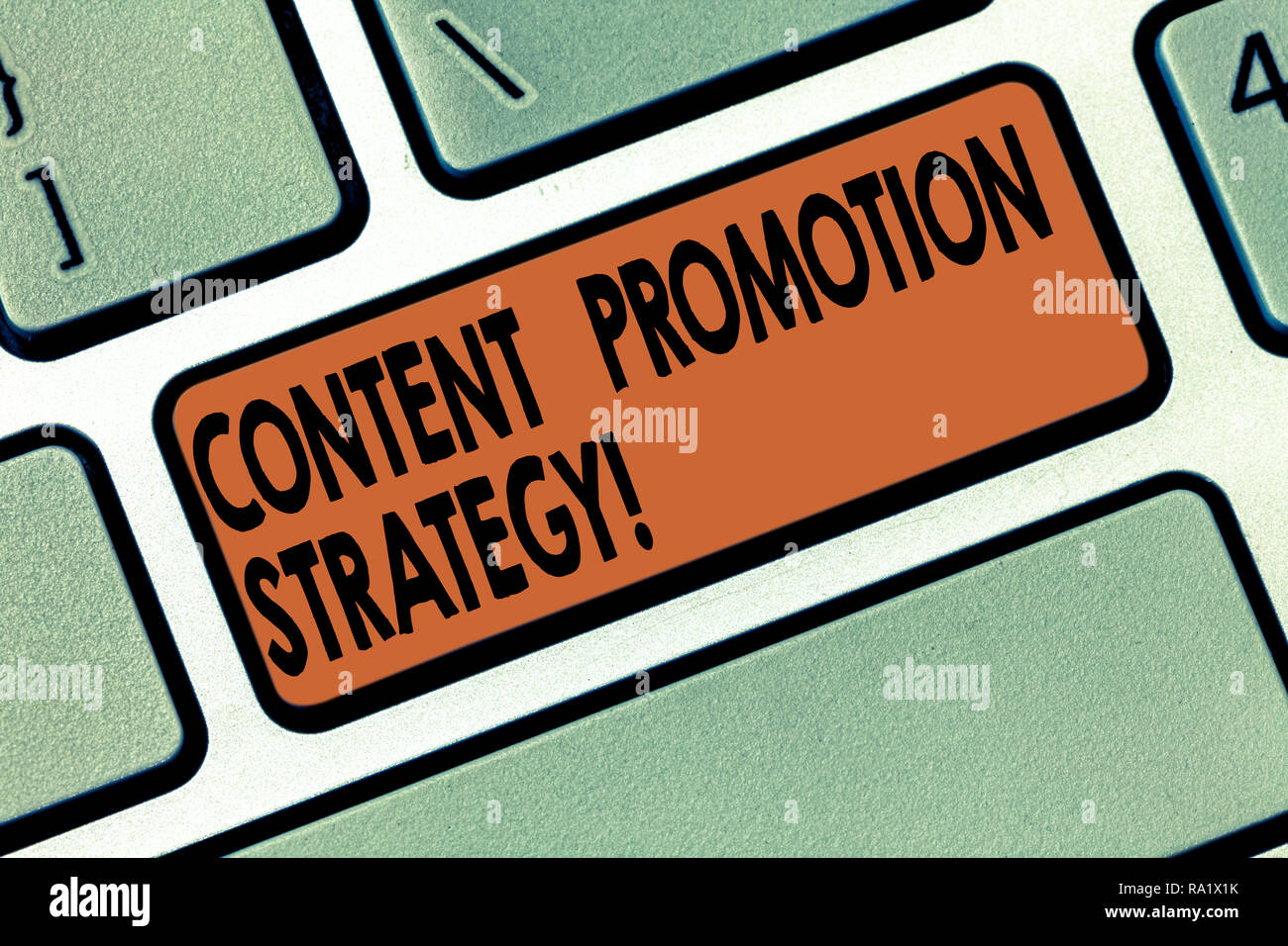 Handwriting text writing Content Promotion Strategy. Concept meaning engage with audience over paid social promotions Keyboard key Intention to create - Stock Image