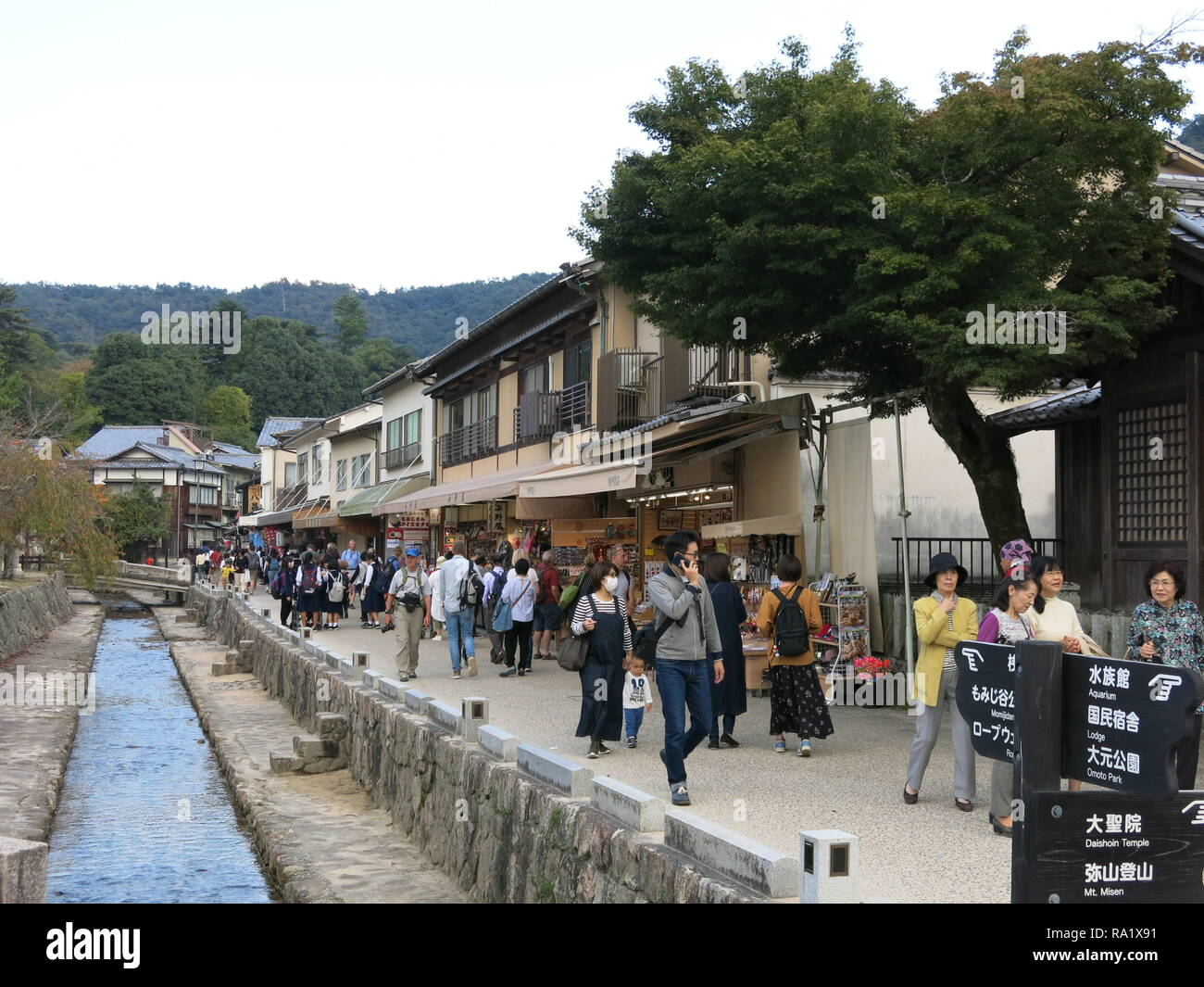 Tourists throng the streets on Miyajima Island, Japan - Stock Image