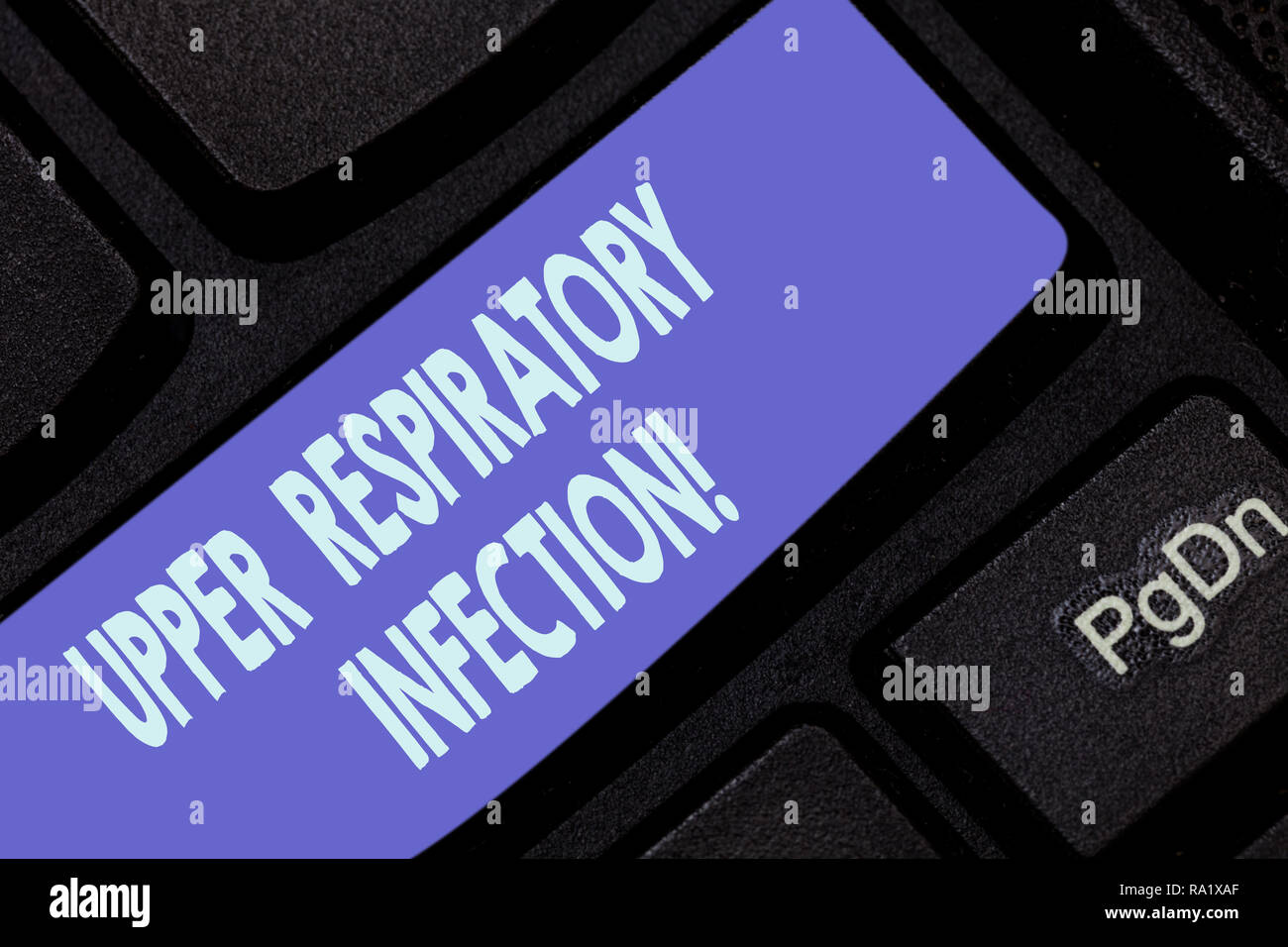 Handwriting text writing Upper Respiratory Infection. Concept meaning illnesses caused by an acute infection Keyboard key Intention to create computer - Stock Image