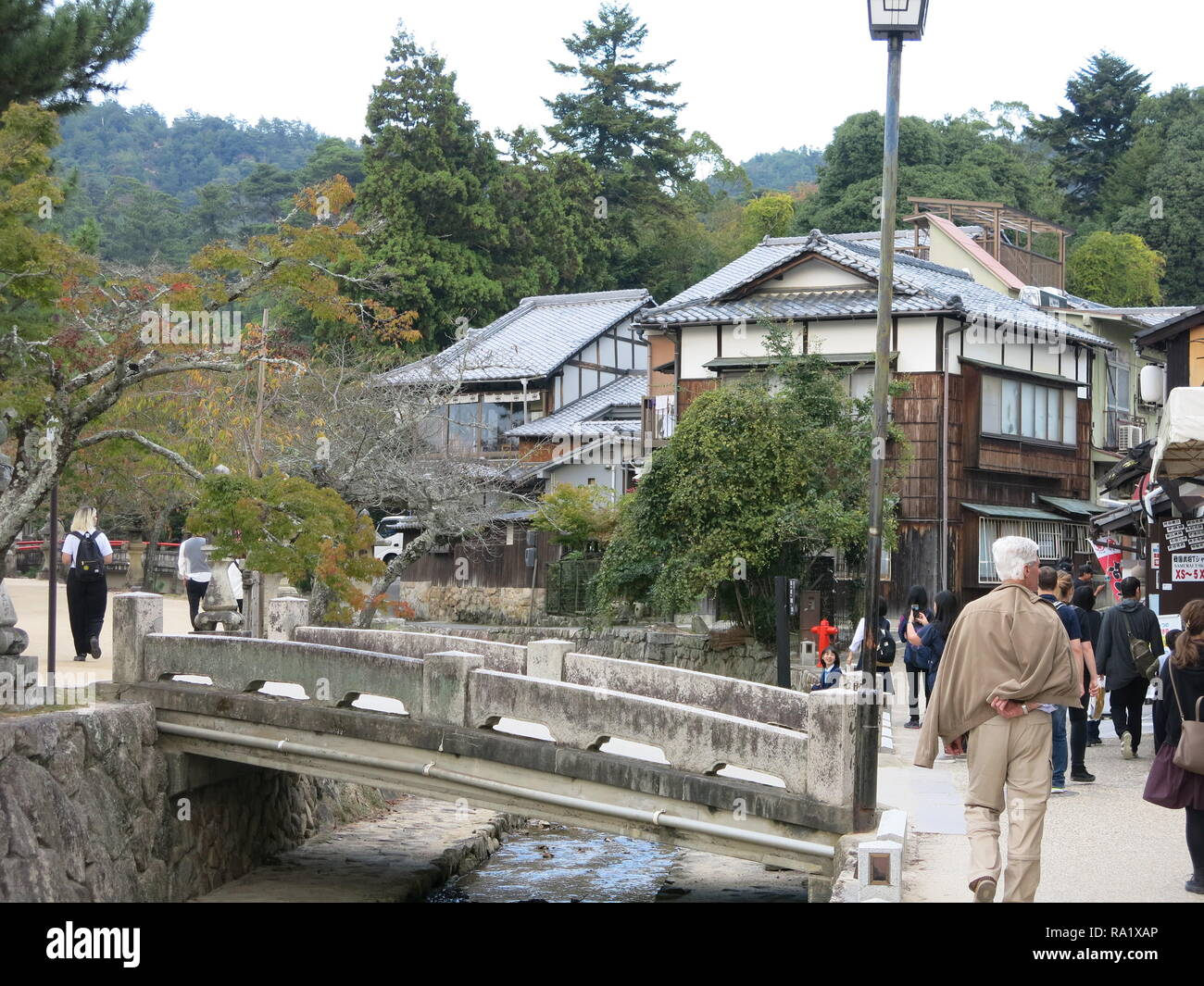 Street scene, Miyajima Island, Japan; the quaint streets are thronged with tourists - Stock Image