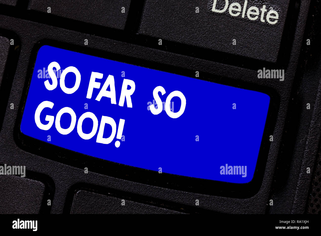 Handwriting text writing So Far So Good. Concept meaning progress has been satisfactory up to now Everything is fine Keyboard key Intention to create  - Stock Image