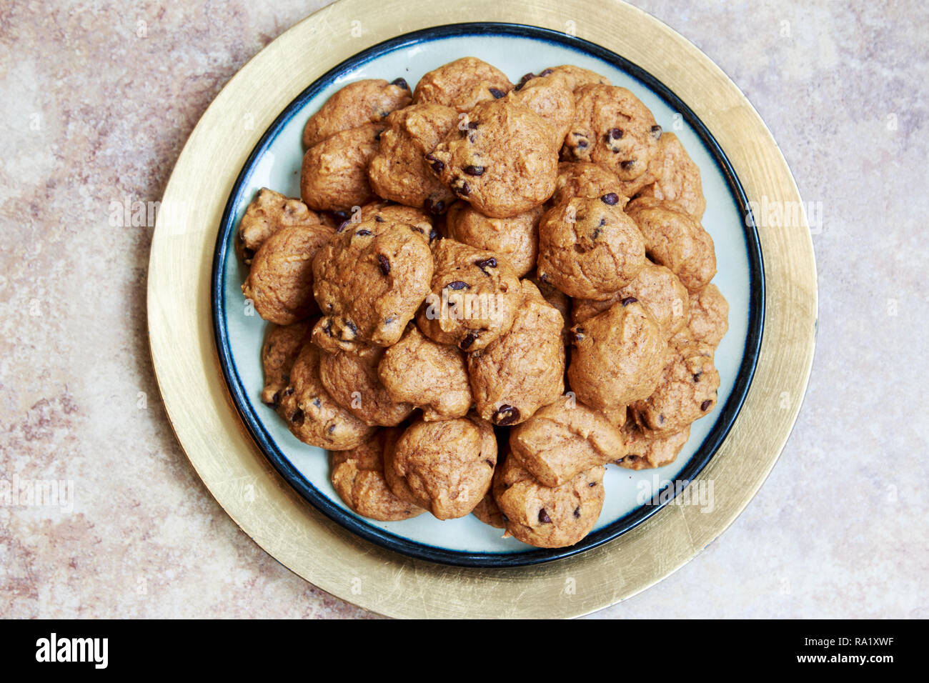Homemade Pumpkin Chocolate Chip Cookies served on a plate. Stock Photo