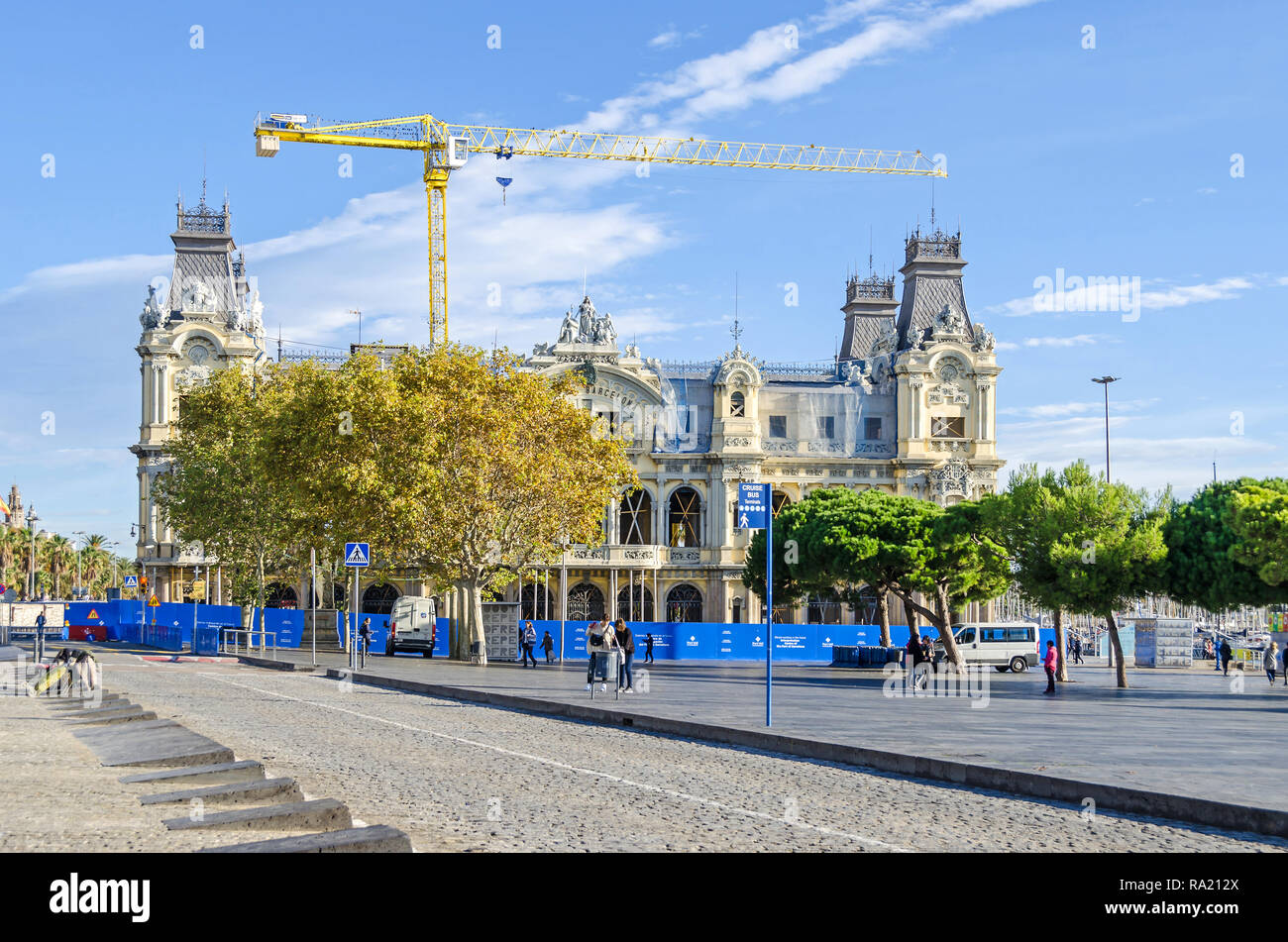 Barcelona, Spain - November 10, 2018:  Old Port Authority building at the base of Rambla del Mar of the Port Vell under renovation - Stock Image