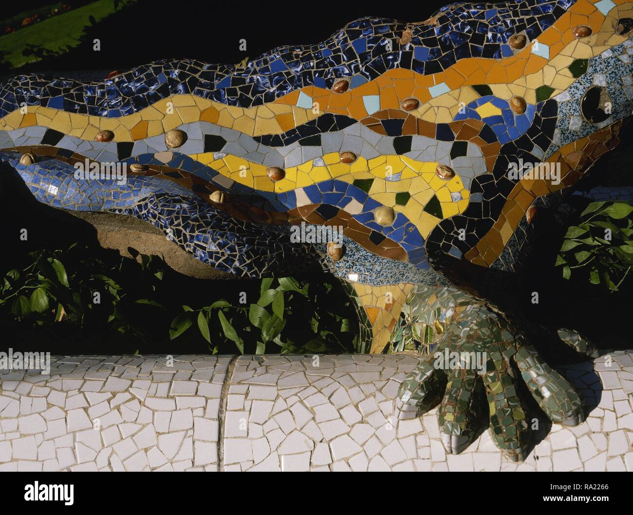 """Barcelona, Catalonia, Spain. Park Guell, designed by Modernist architect Antonio Gaudi (1852-1926). Salamander, Dragon fountain, known as """"The Dragon"""". Park entrance. 1900-1914. Detail. Stock Photo"""