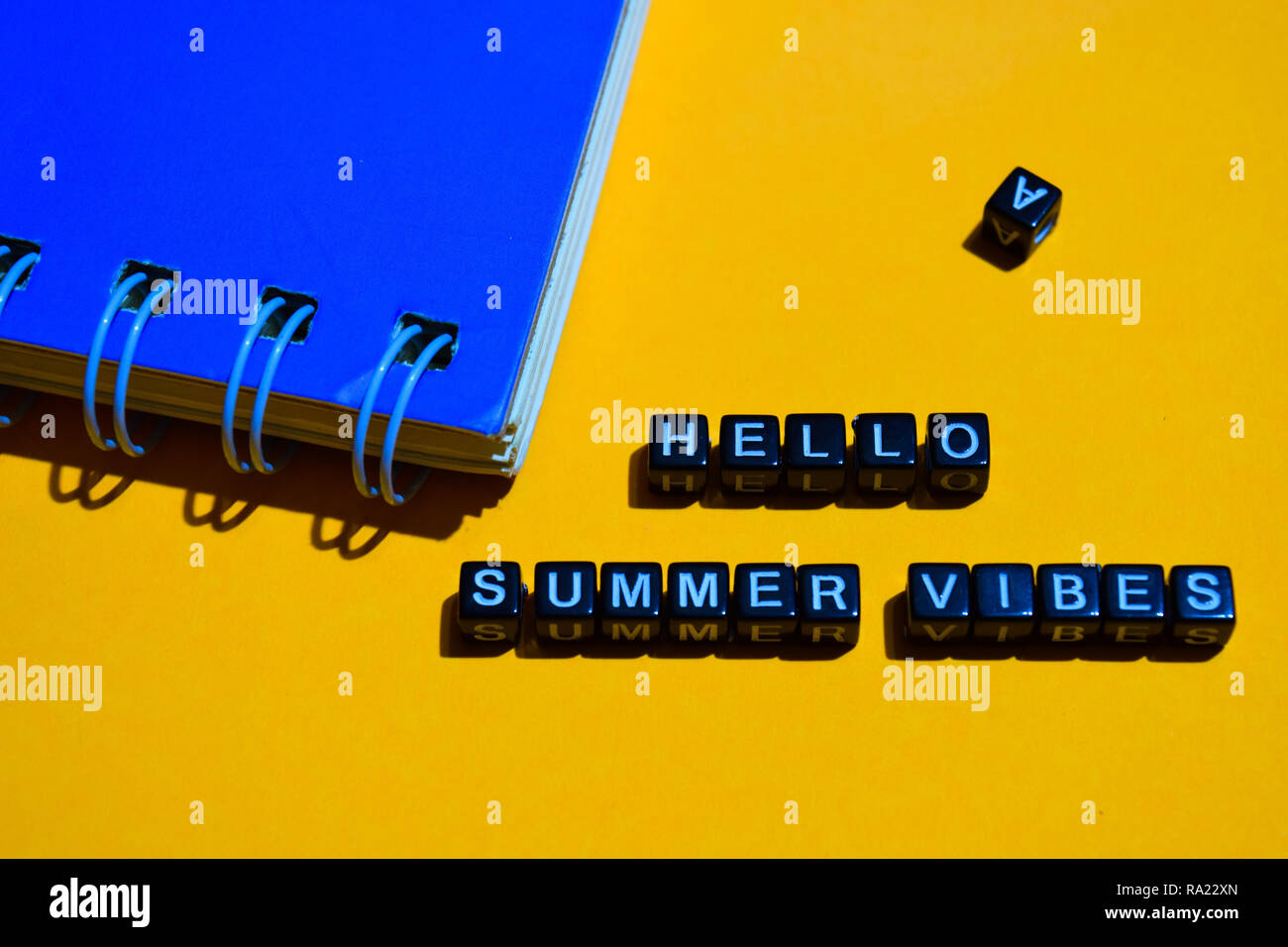 Hello summer vibes on wooden blocks. business concept on orange background Stock Photo
