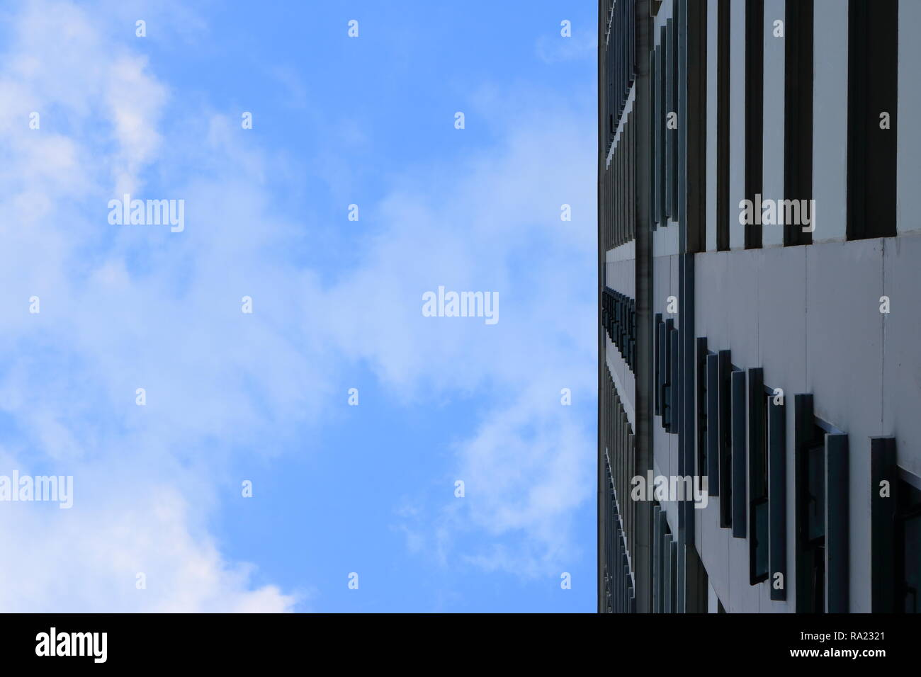 blue sky with white clouds above high building Stock Photo