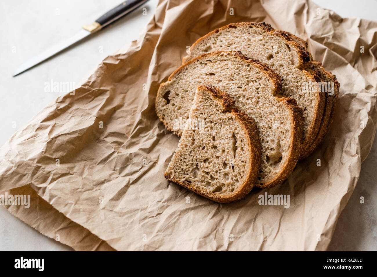Artisan Sliced Homemade Sourdough Bread Slices with Paper Bag / Package or Craft Paper. Organic Bakery Food.