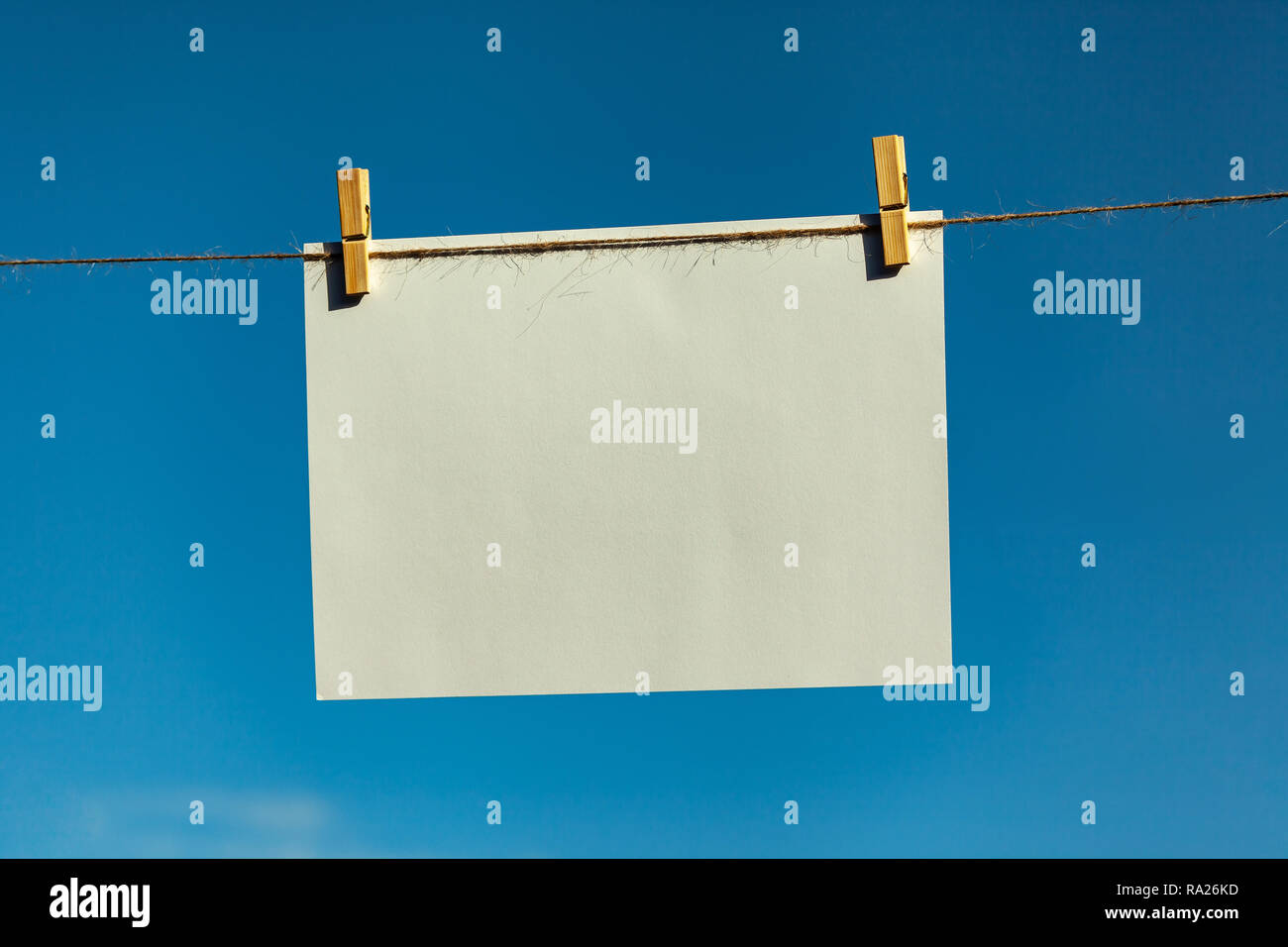 Pegs and paper on a line - Stock Image