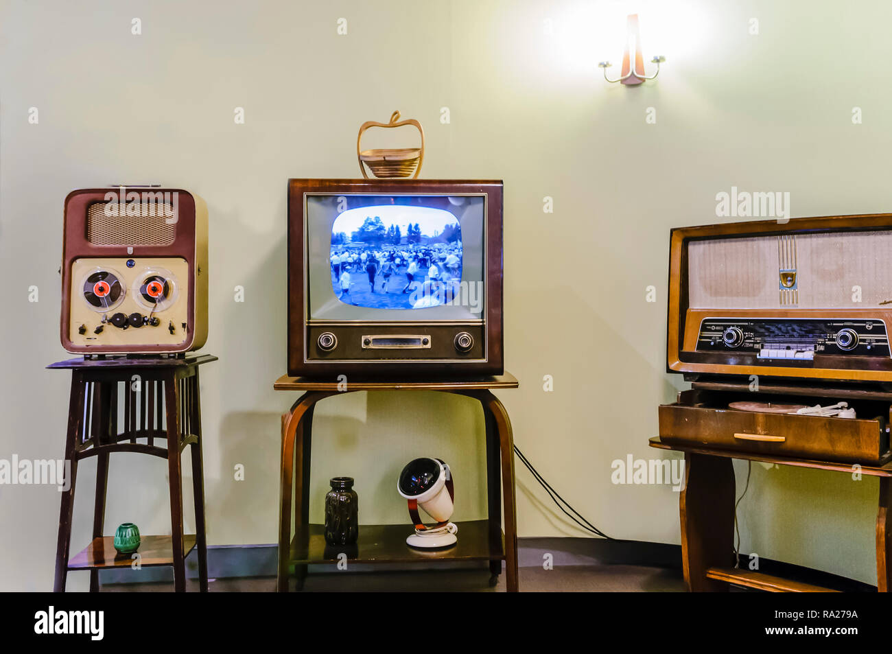 Reel to Reel player, black and white television and an old medium/long wave radio in a living room from the 1950s. Stock Photo