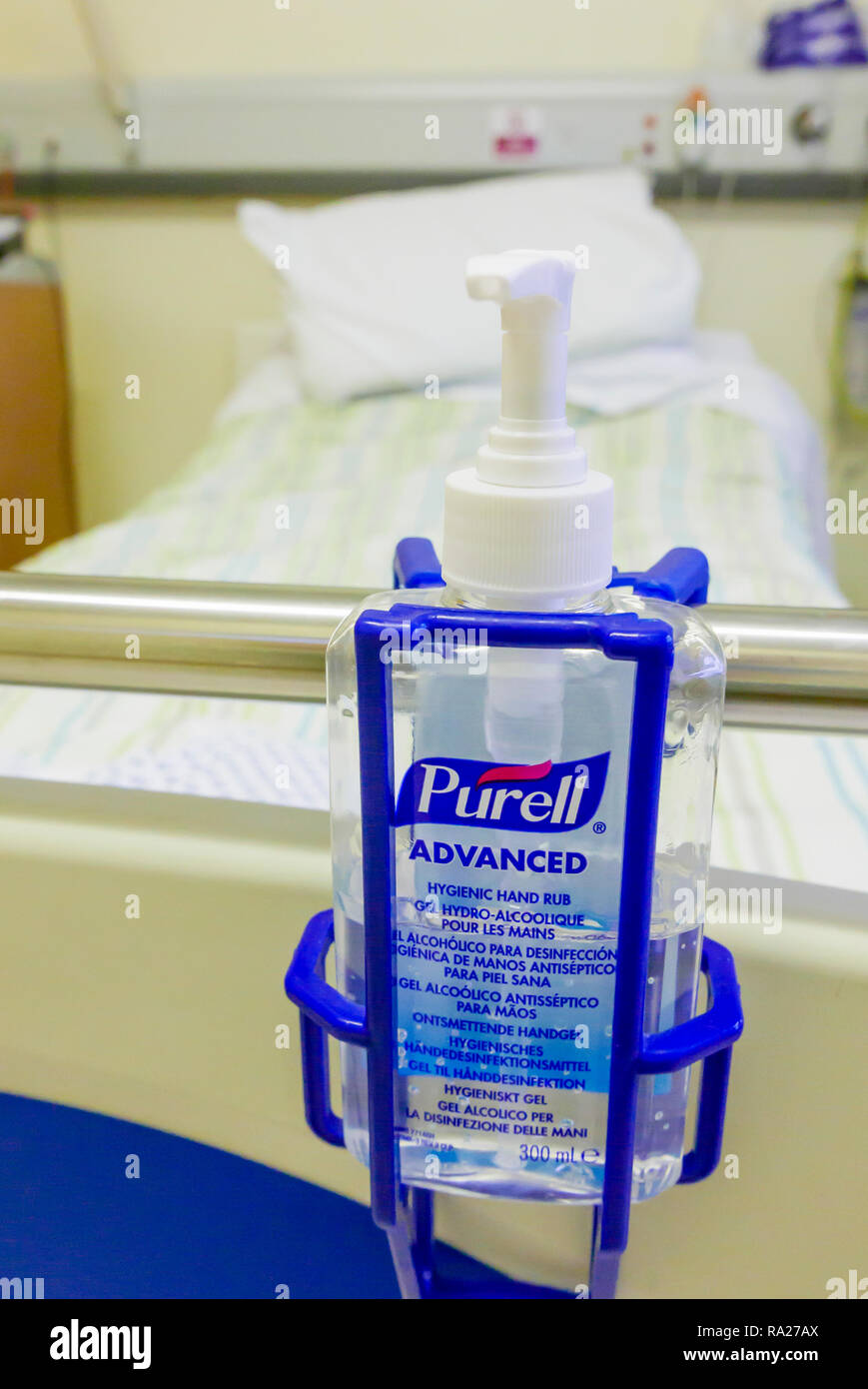 Bottle of Purell Advanced alcohol hygienic hand rub at the end of a hospital bed. - Stock Image