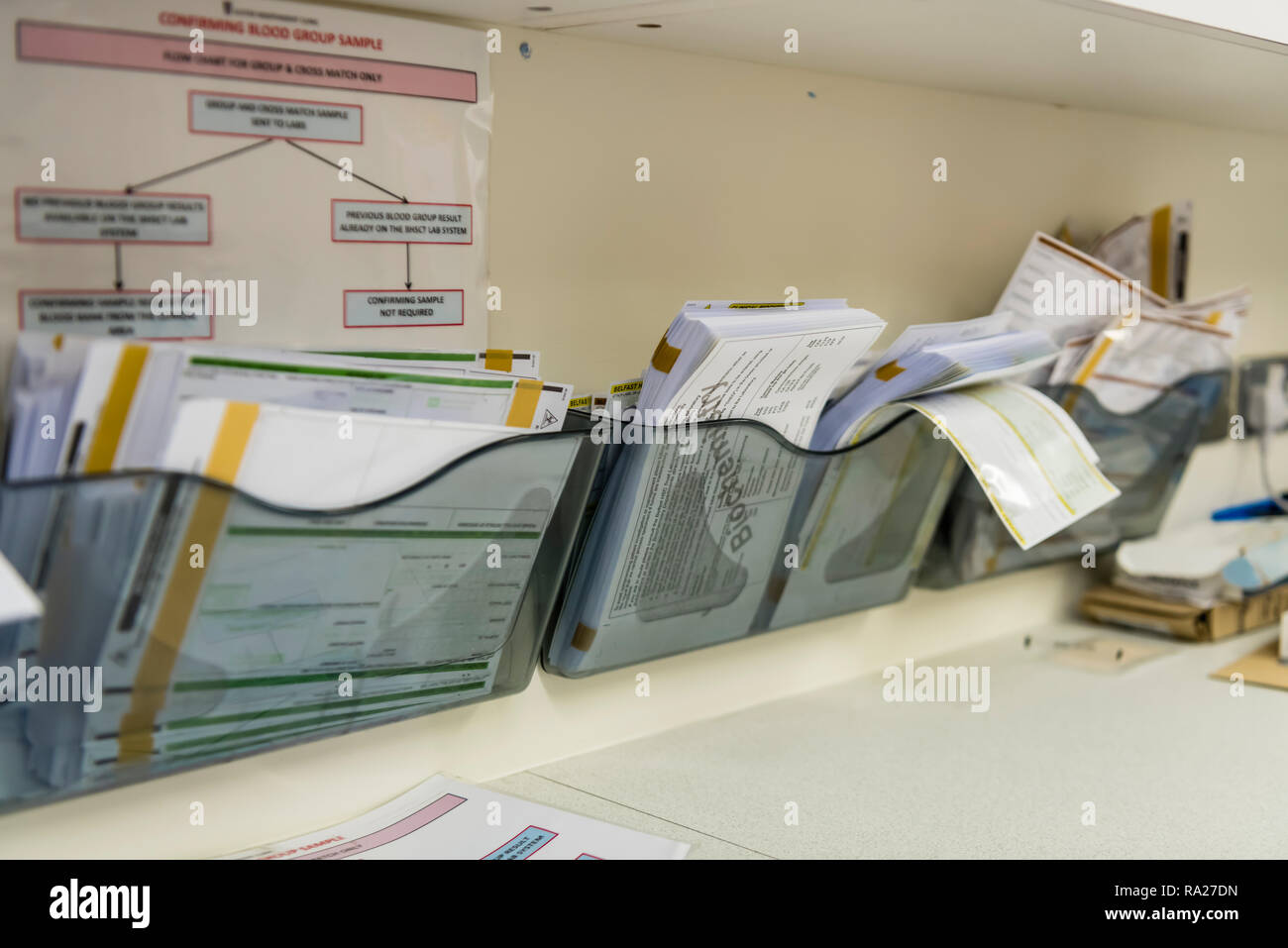 Forms for blood analysis in a hospital treatment room - Stock Image