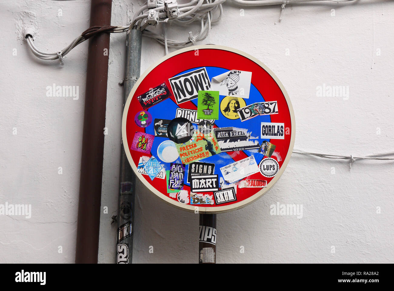 No waiting street sign covered in stickers in Granada, Spain. - Stock Image