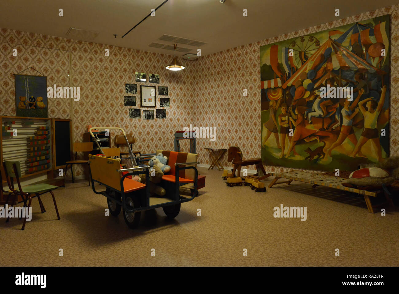 Typical room facilities of a kindergarten in the former GDR, displayed in the DDR museum in Berlin Mitte. - Stock Image