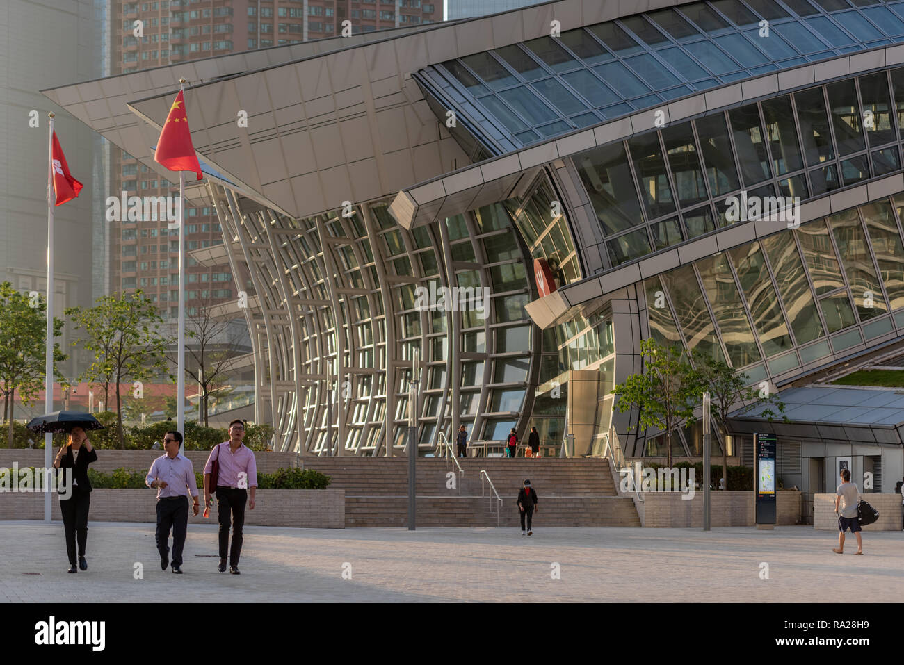 Hong Kong West Kowloon station, the gateway to Hong Kong's high speed rail links with Mainland China, in late afternoon November sunshine. - Stock Image