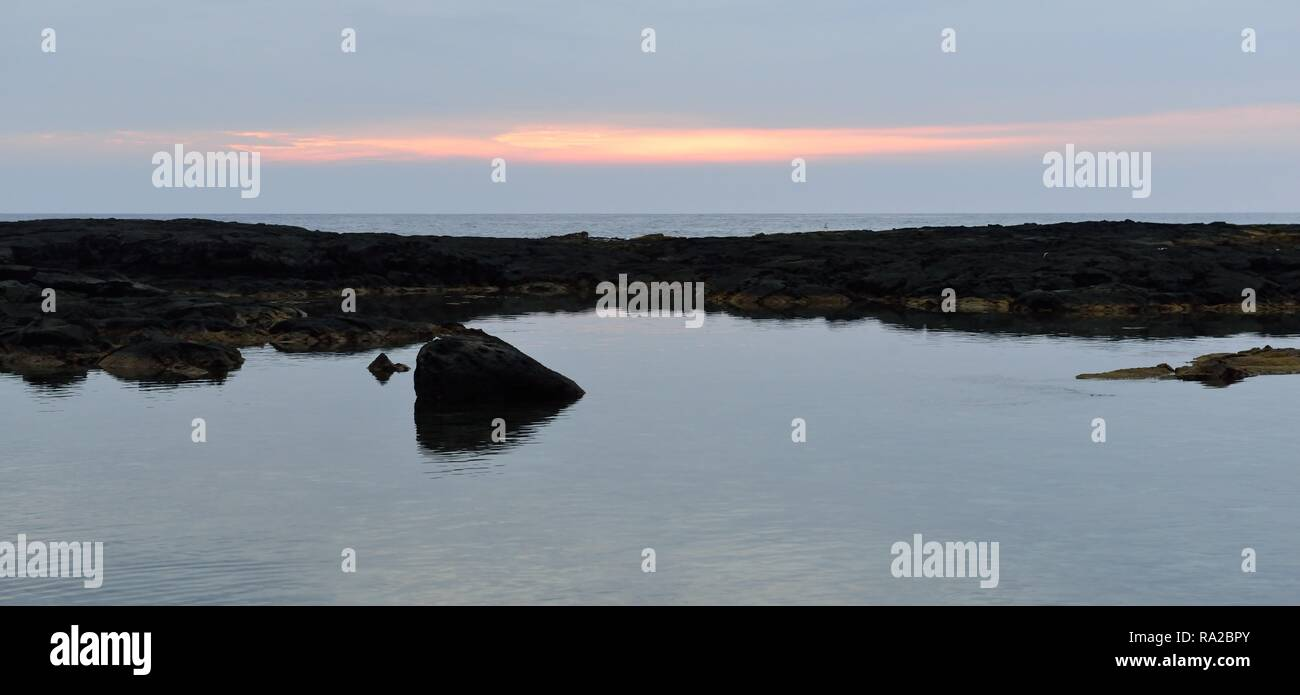 sunset at the beach of Pu'uhonua o Honaunau the Place of Refuge Big Island of Hawaii - Stock Image
