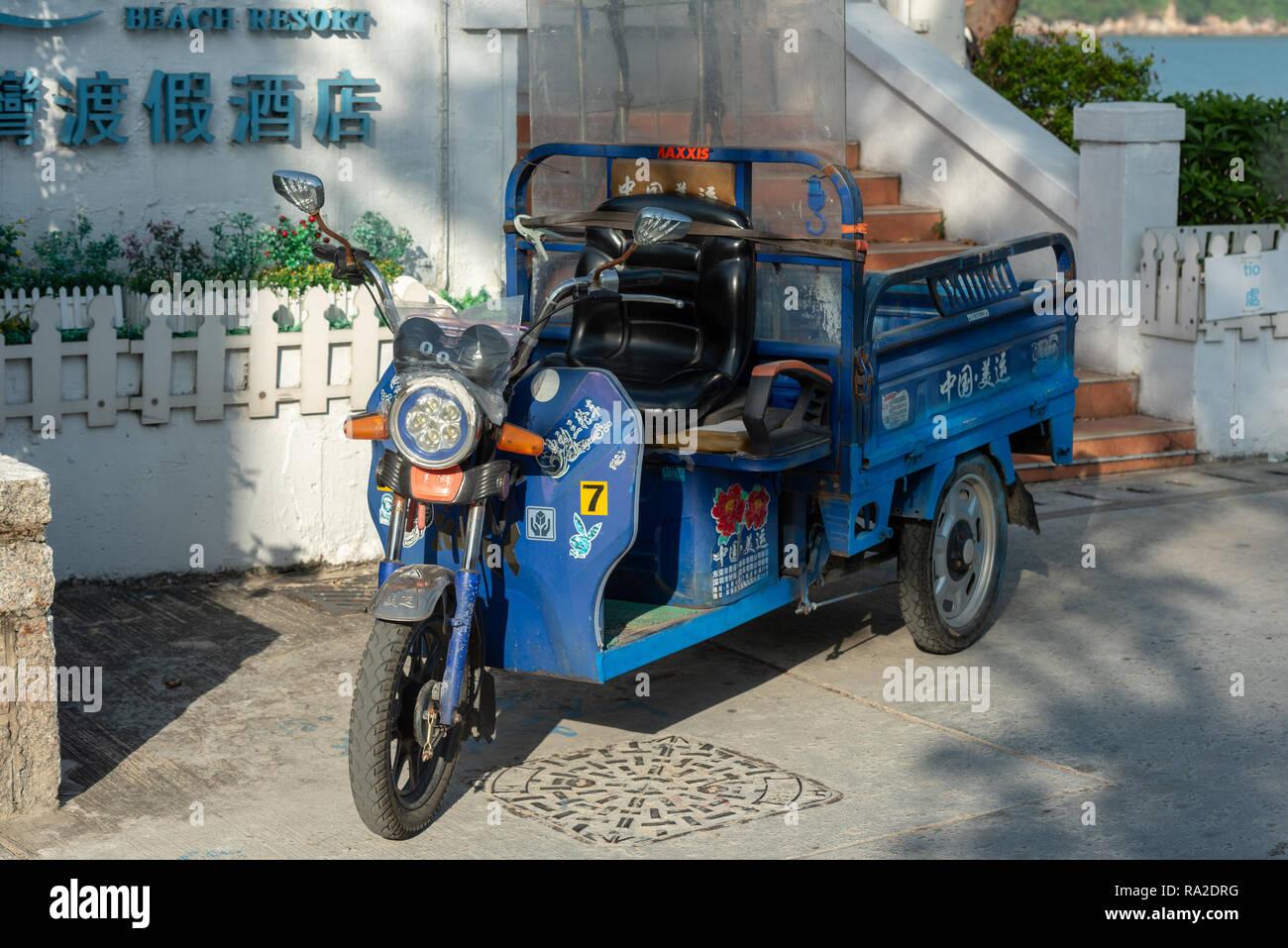 Colourful motorised transport at the Silvermine Beach Resort at Mui Wo on Lantau Island, Hong Kong - Stock Image