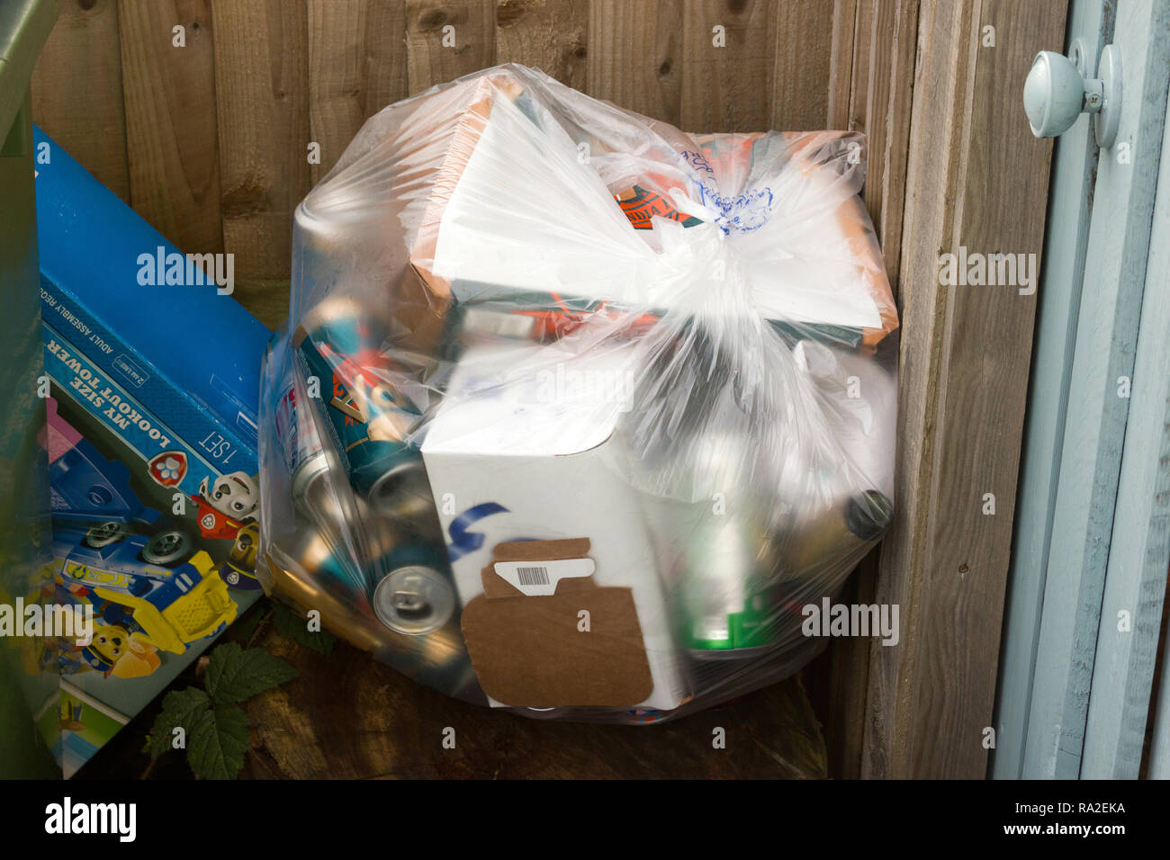 Bag of domestic rubbish awaiting collection - Stock Image