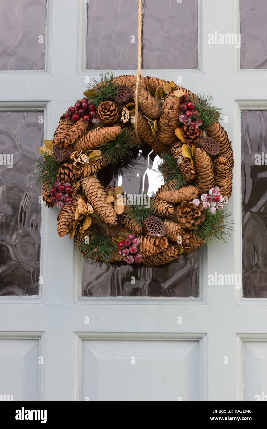 Decorative wreaths on a front door Stock Photo - Alamy