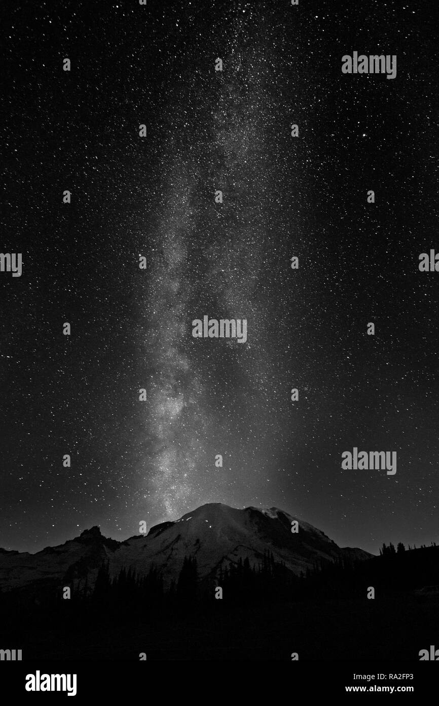 WA15644-00...WASHINGTON - The Milkyway over the summit of Mount Rainier from Sunrise in Mount Rainier National Park in black and white. - Stock Image