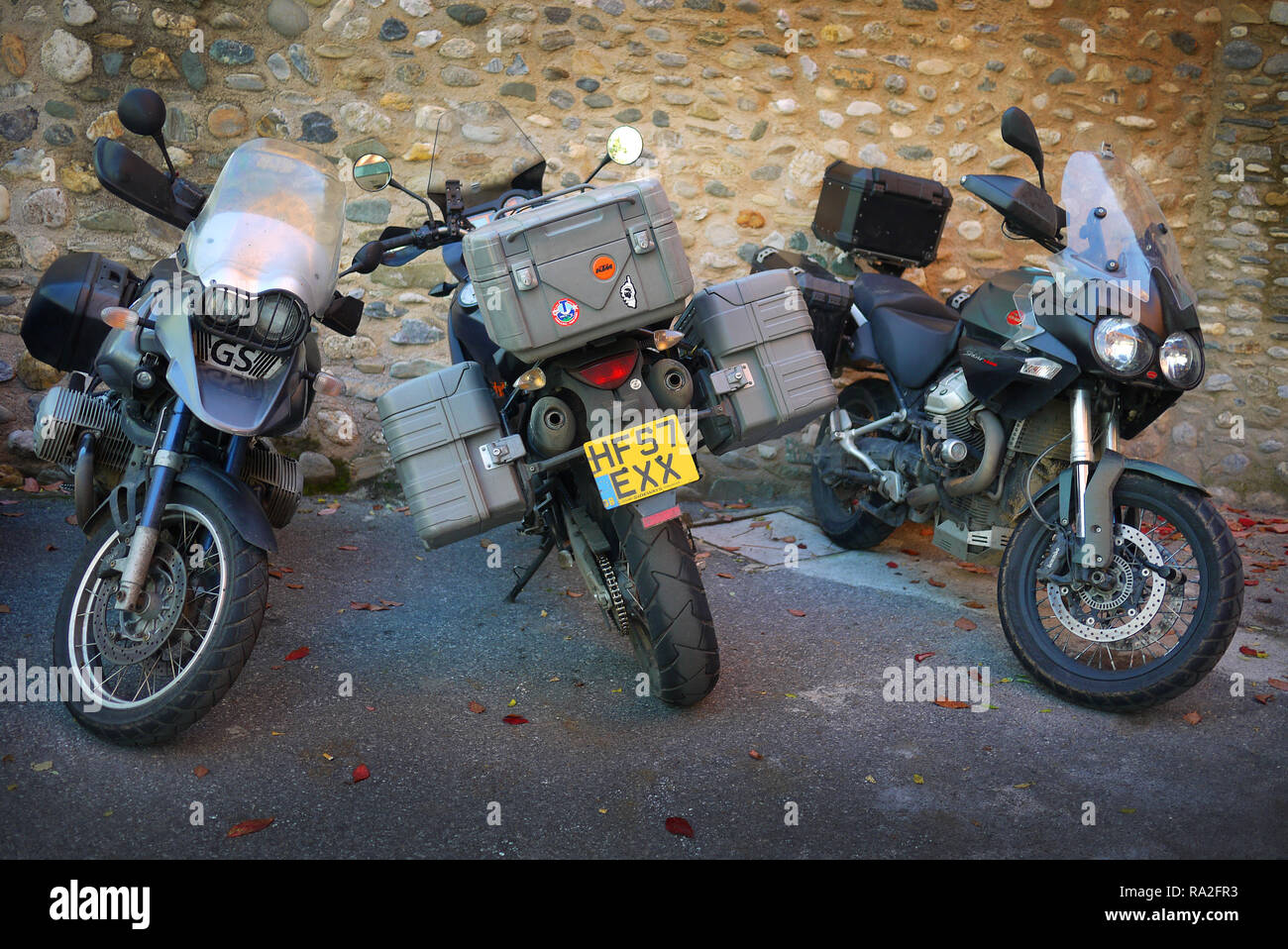Adventure touring motorcycles, BMW, KTM and Moto Guzzi, Granada, Spain. - Stock Image