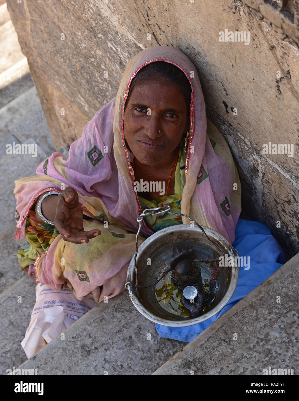 Poverty-stricken Asian female begging for money on the streets of Udaipur, Rajasthan, Western India, Asia. - Stock Image