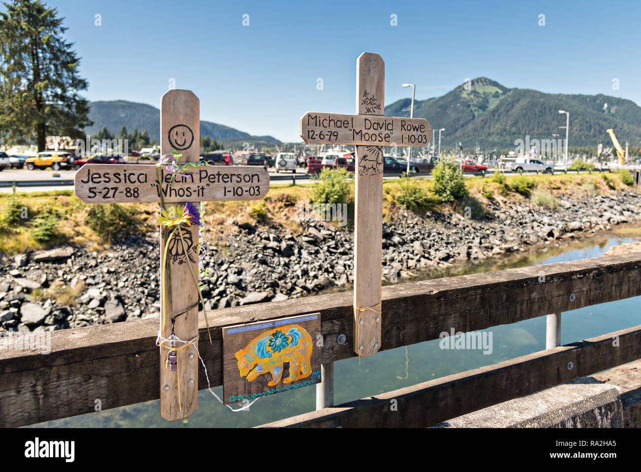 Two crosses form a memorial for two young people who died on the Sing Lee Alley bridge across Hammer Slough in Petersburg, Mitkof Island, Alaska. Petersburg settled by Norwegian immigrant Peter Buschmann is known as Little Norway due to the high percentage of people of Scandinavian origin. Stock Photo