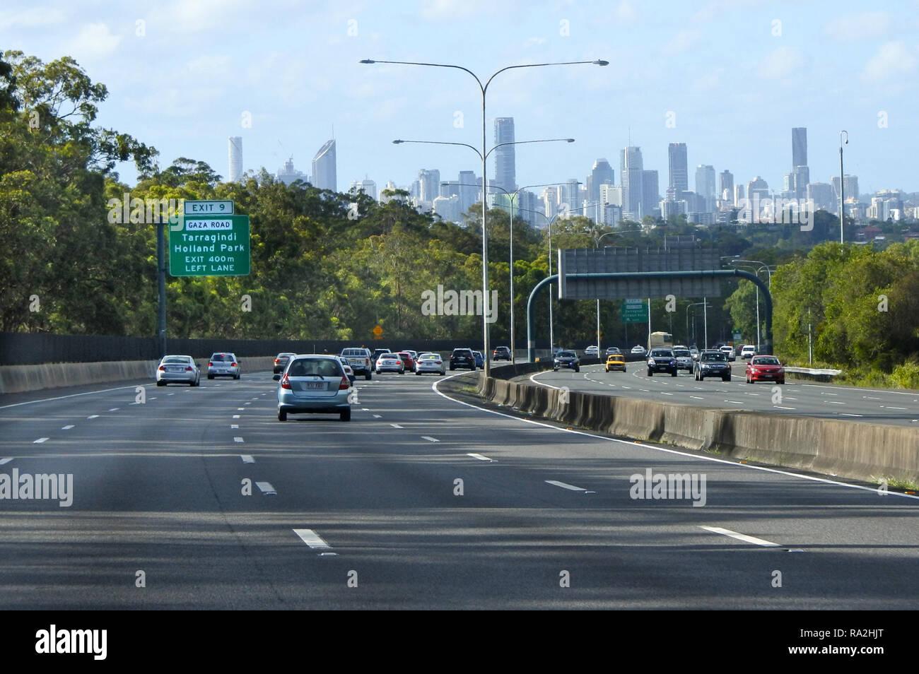 Brisbane City Skyline from Pacific Motorway in Queensland, Australia.Pacific Motorway is 150 Km (93 mi) long, features eight tr - Stock Image