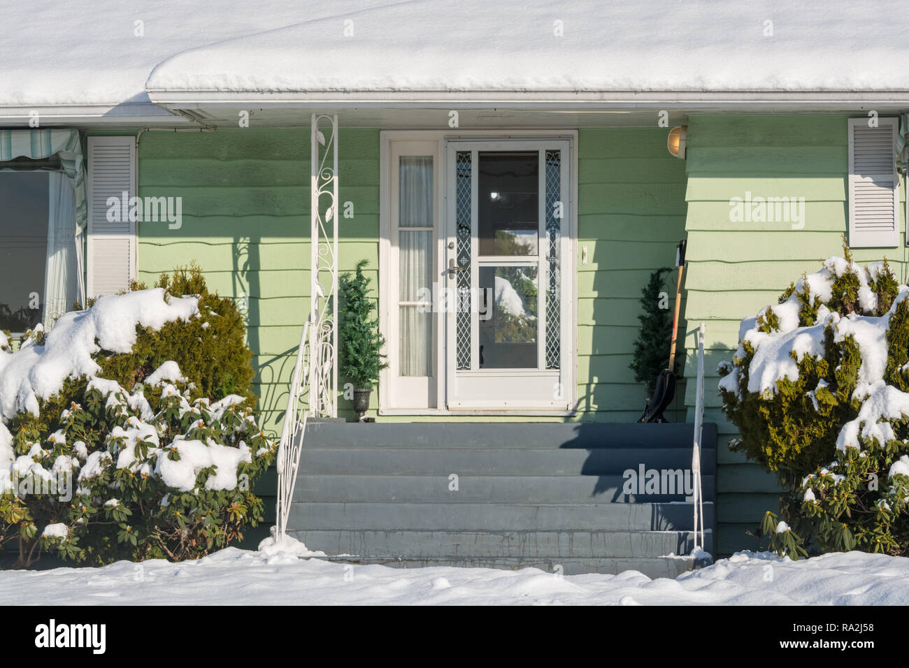 Residential house entrance on bright winter day in Canada - Stock Image
