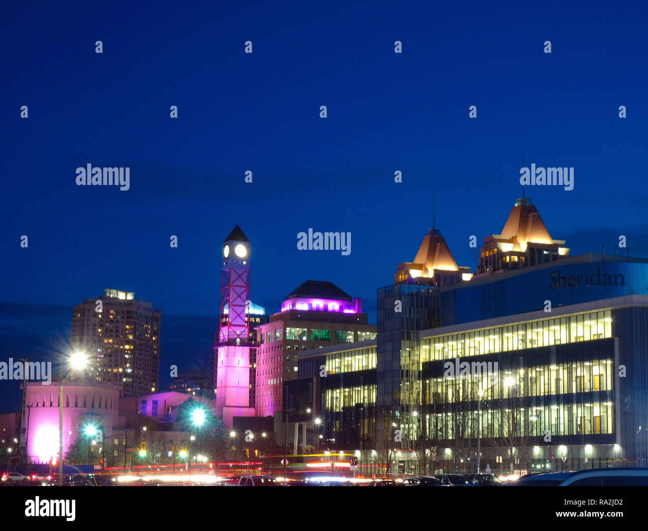 Various shots of Toronto taken during the blue hour. The blue sky is contrasted against the warm glow of the city's lights. - Stock Image