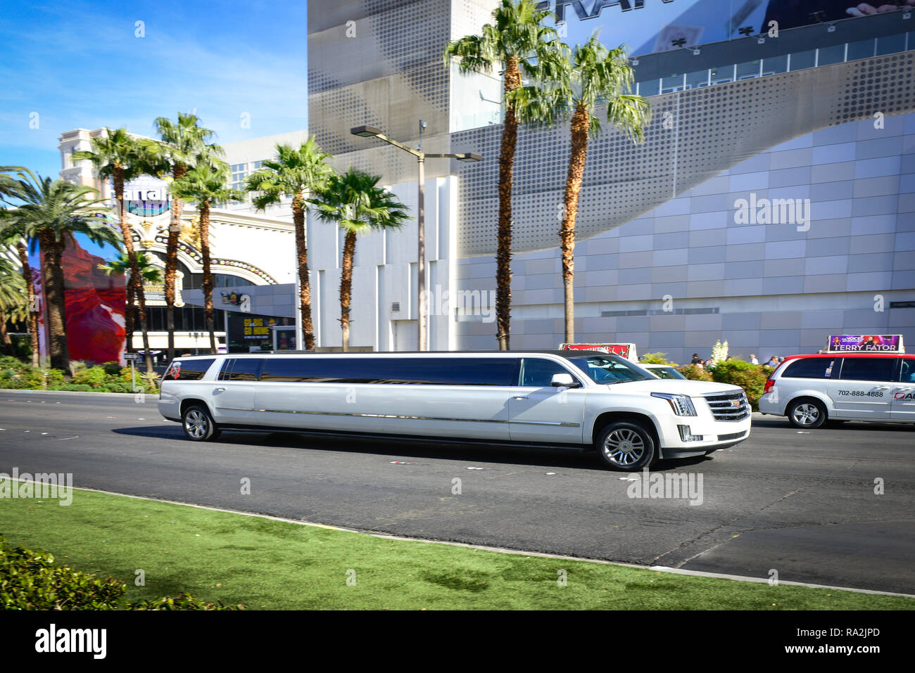 A white Cadillac stretch limousine traveling on the Las Vegas Strip in front of the Linq Hotel and Casino in Las Vegas, NV on a sunny day Stock Photo