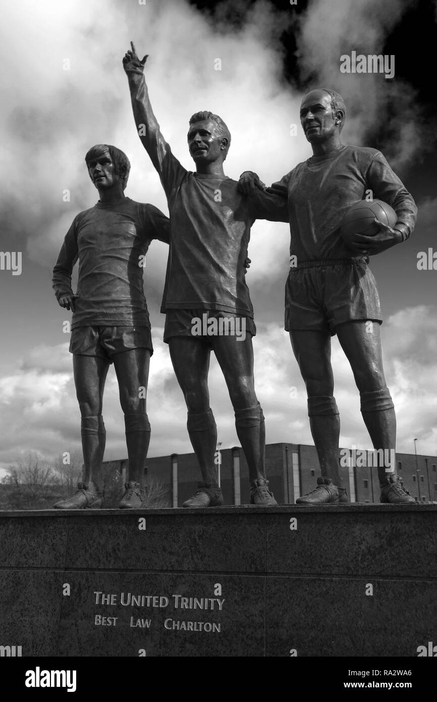 The United Trinity sculptor by Philip Jackson, Manchester United's 'Old Trafford' ground, Manchester, England, UK - Stock Image