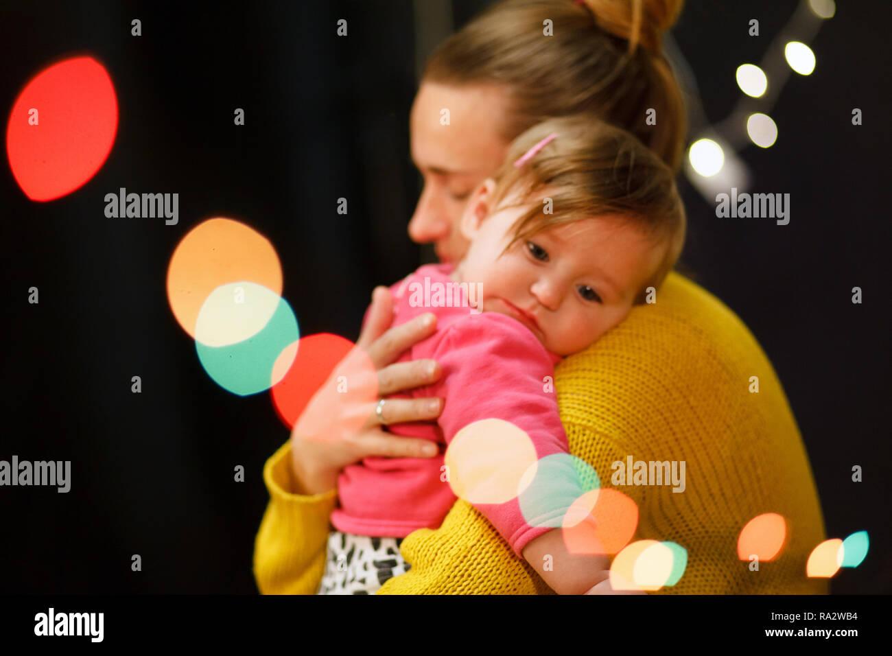 Mother hugs a little girl who cries. Maternal love. Soft focus - Stock Image
