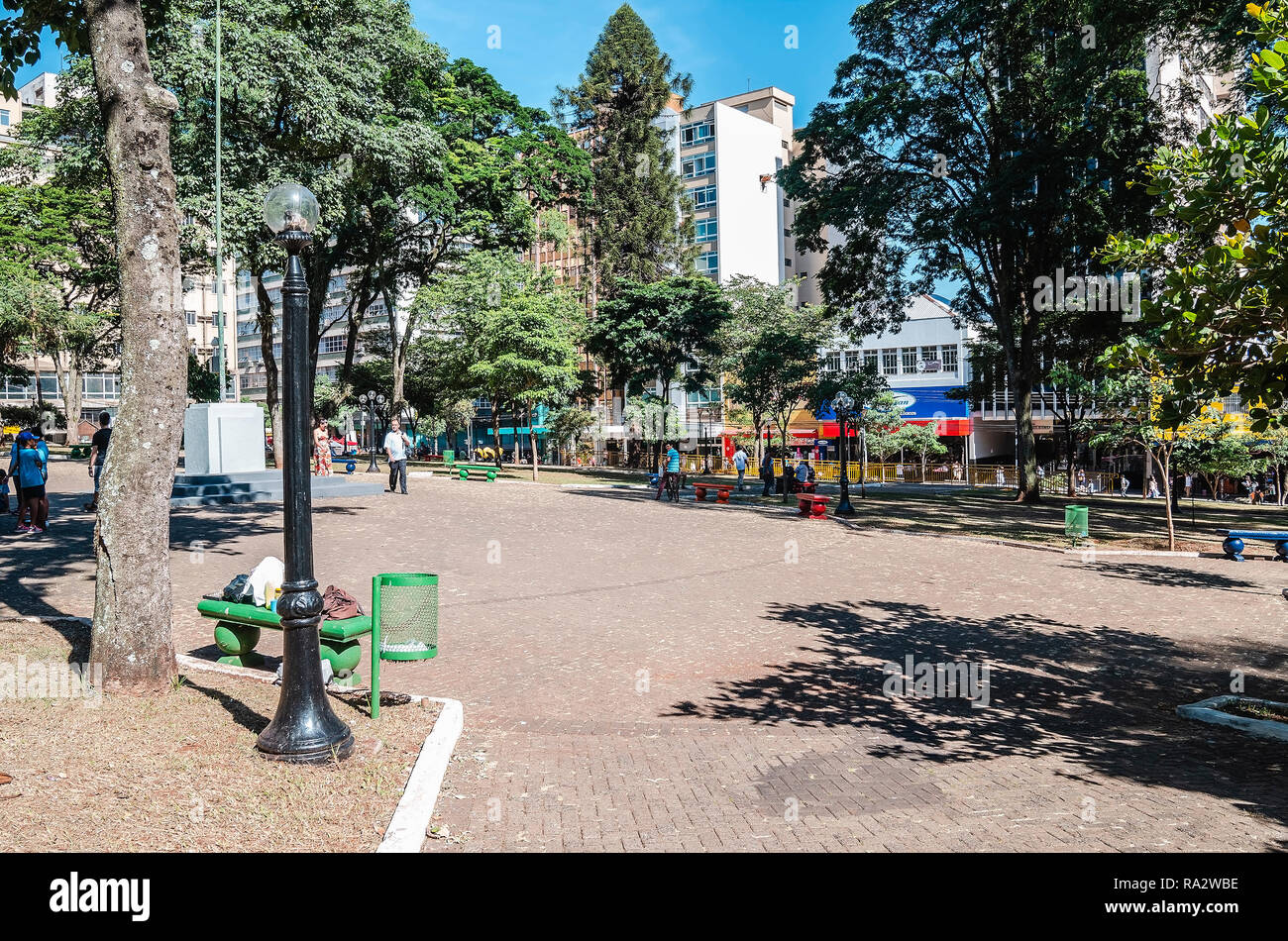 Londrina - PR, Brazil - December 12, 2018: Ordinary day at Marechal Floriano Peixoto square (Praça da Bandeira) in Londrina city. Square with people,  - Stock Image