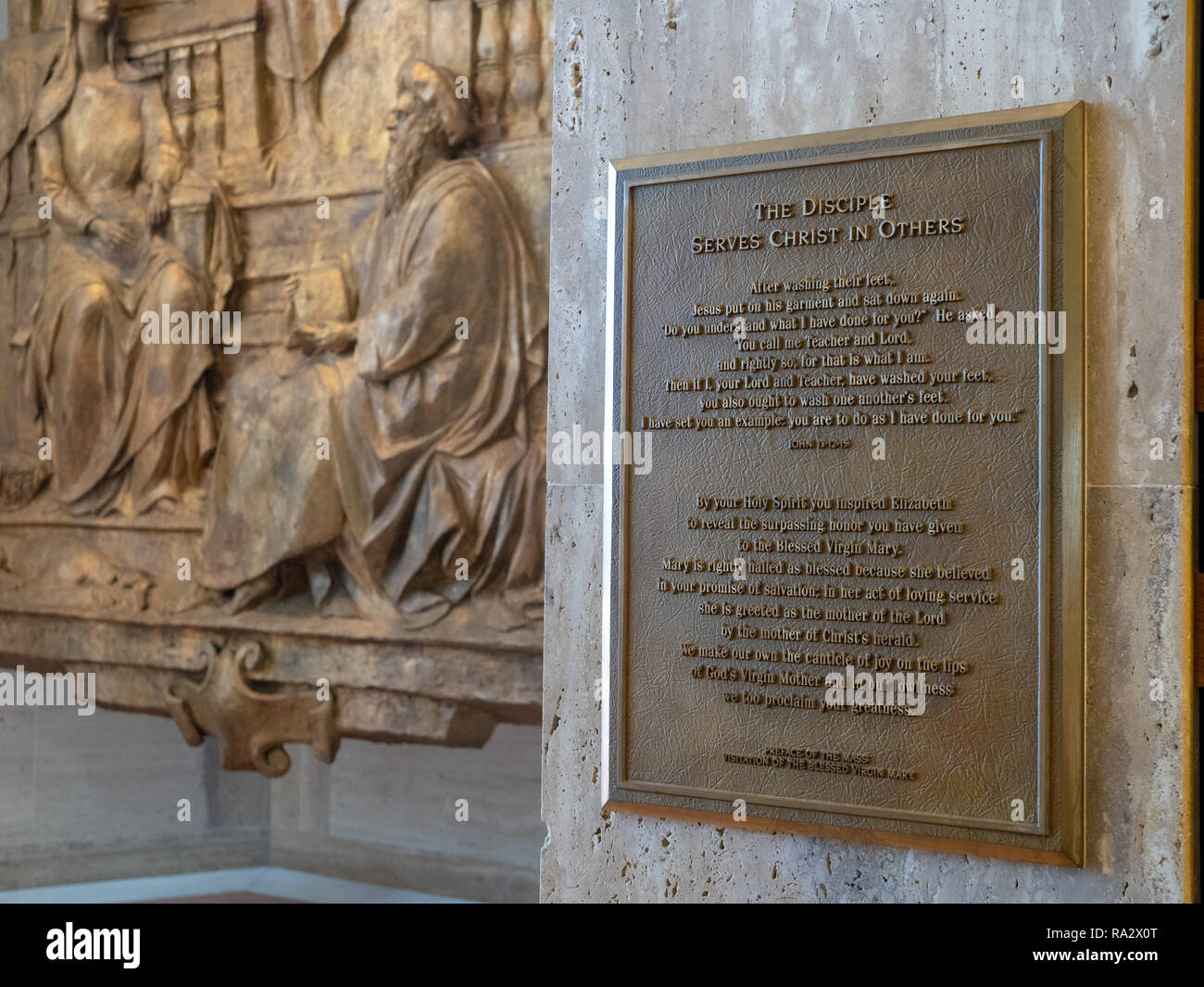 The disciple serves Christ in others plaque story and mural at Cathedral Of Saint Mary Of The Assumption - Stock Image