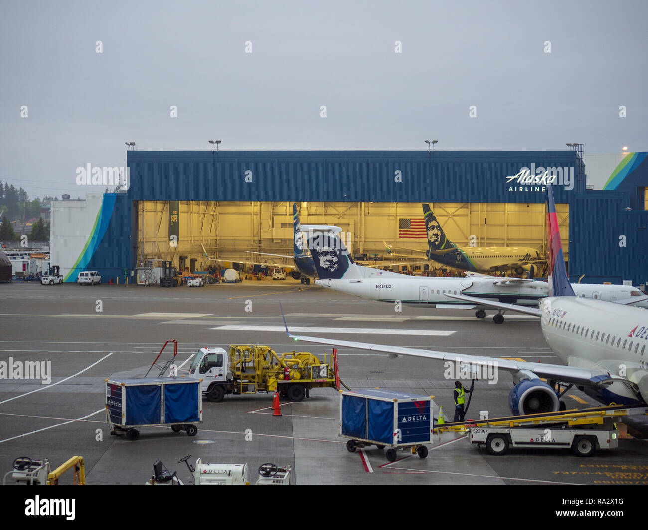 Alaska Airlines hanger and airplane at Seattle Tacoma International Airport terminal - Stock Image